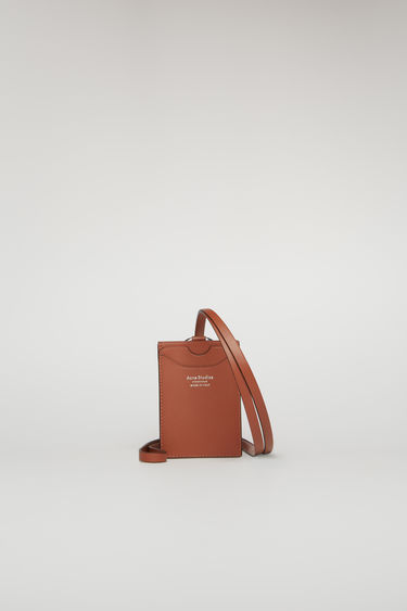 Acne Studios almond brown lanyard doubles as a cardholder - it's crafted from smooth leather and features four card slots and a logo-engraved ring clasp.