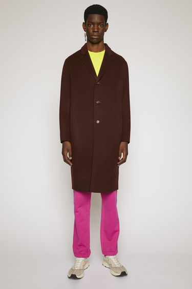 Acne Studios Chad maroon red coat is crafted to an oversized silhouette from soft wool and features a three-button closure and notch lapels.