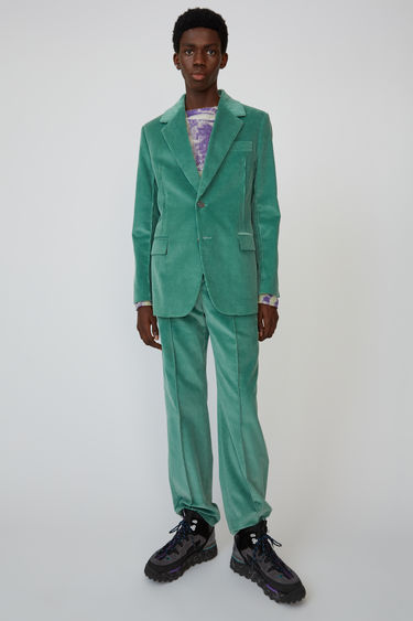 Acne Studios dusty green suit jacket is cut from cotton-corduroy and shaped with wide lapels and padded shoulders.