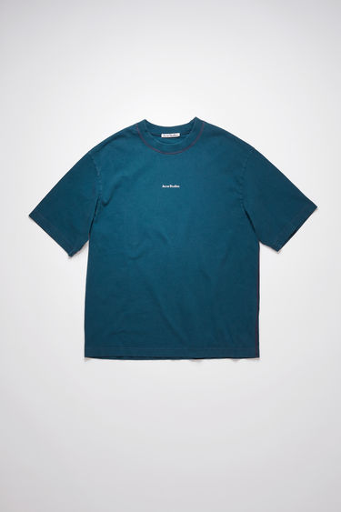 Acne Studios deep petrol t-shirt is crafted from organically grown cotton that's garment dyed to create a soft, washed out finish. It's cut for a relaxed fit and features a raised logo lettering on front.