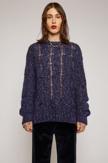 Acne Studios navy/lilac sweater is loosely knitted with different shades of yarn in a cable-knit pattern and finished with ribbed trims along the neck, cuffs and hem.
