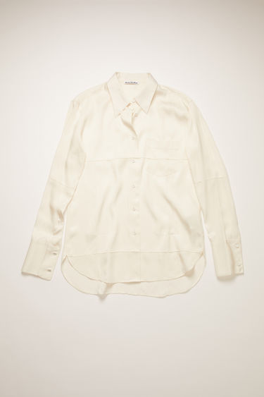 Acne Studios warm white shirt is crafted from a viscose blend with a hint of silk and cut to a relaxed silhouette for a fluid drape. It's shaped with a point collar and buttoned cuffs and features pintucking techniques.