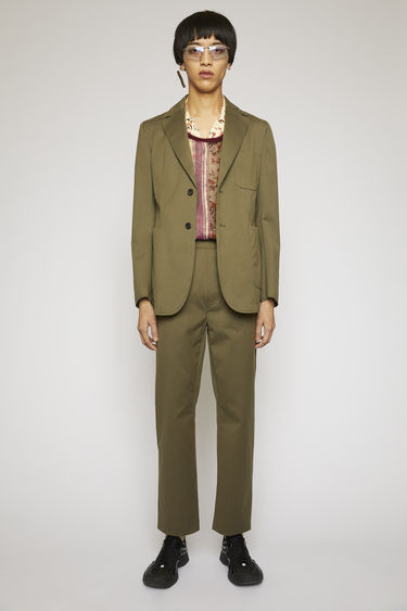 Acne Studios olive green/lilac purple pinstriped suit jacket is crafted from a lightweight cotton-blend suiting and features lightly padded shoulders and patch pockets.