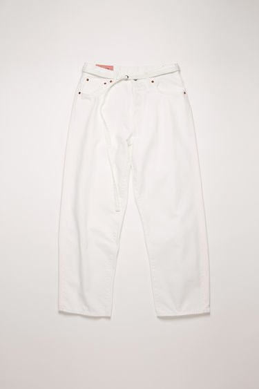 Acne Studios 1991 Toj White jeans are crafted from rigid denim and shaped with wide, straight legs. They can be worn on the natural waistline or pulled to a high rise with a matching belt.  The female model is wearing two sizes larger than her actual size to achieve a looser fit.