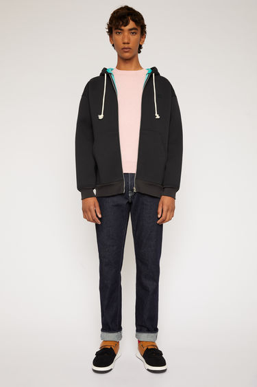 Acne Studios black hooded sweatshirt is made from bi-colour bonded fleece and finished with a front zip closure and a tonal face-embroidered patch.