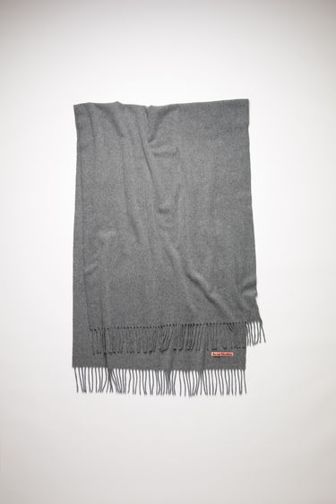 Acne Studios grey melange oversized fringed scarf is made of pure wool, featuring a label in one corner.
