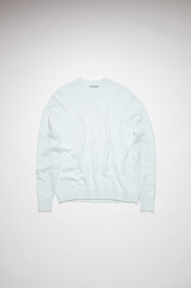 Acne Studios light blue crew neck sweater is made of pure, shiny cotton with ribbed accents.