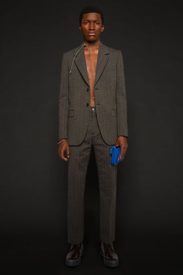 Acne Studios graphite/anthracite grey trousers are made from custom-developed suiting fabric that's woven with tonal pinstripes. They're cut in a straight-leg shape with a mid-rise waistband, and finished with side pockets and welt pockets at the back.