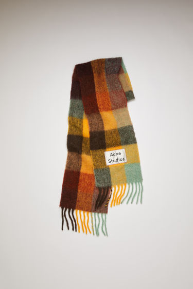 Acne Studios chestnut brown/yellow/green fringed scarf is woven in multi check pattern and detailed with a logo patch.