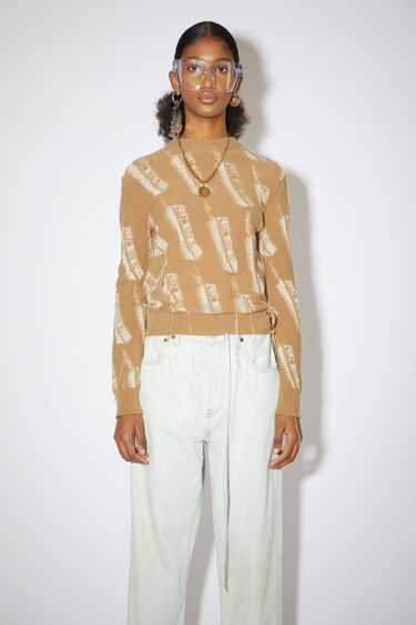 Acne Studios camel brown crew neck sweater features a phone intarsia knit design with loose yarn.