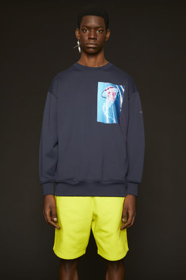 Acne Studios navy blue sweatshirt is crafted from loopback jersey that holds a subtle lustre and and it features a jellyfish patch across the chest.
