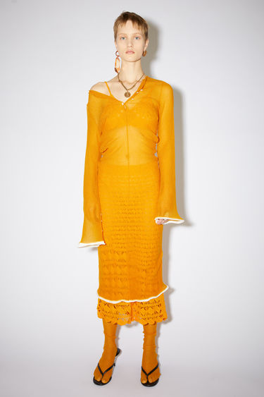 Acne Studios apricot orange sheer dress is made of ribbed, glittering nylon.