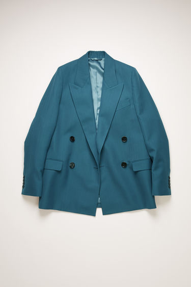Acne Studios teal blue suit jacket is crafted to a boxy silhouette from a wool-blend and has lightly padded shoulders, peak lapels and a double-breasted front.