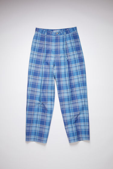 Acne Studios blue/navy wide leg trousers are made of a plaid cotton/polyester blend fabric.