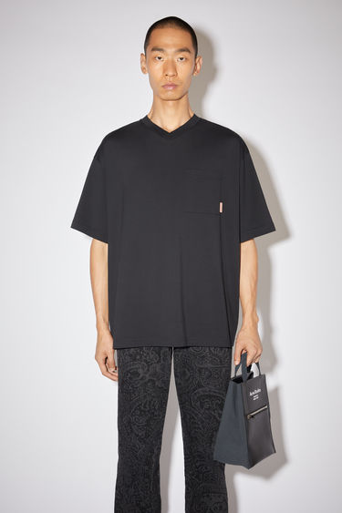 Acne Studios black v-neck t-shirt is made of cotton, featuring a single chest pocket with an Acne Studios logo tab.