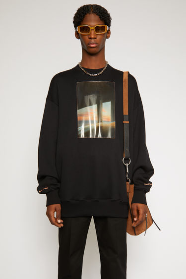 Acne Studios sweatshirt is created in collaboration with photographer Kanghee Kim. It's crafted from midweight technical jersey that holds a subtle lustre and adorned with a large-scale PU patch featuring a surreal landscape print.