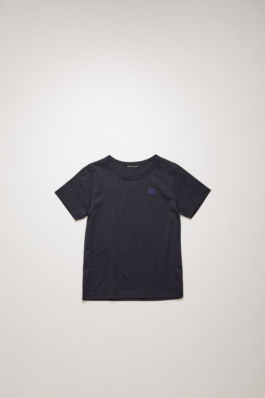 Acne Studios Mini Nash Face navy t-shirt is shaped with a crew neck and short sleeves and finished with a tonal face-embroidered patch on the chest.
