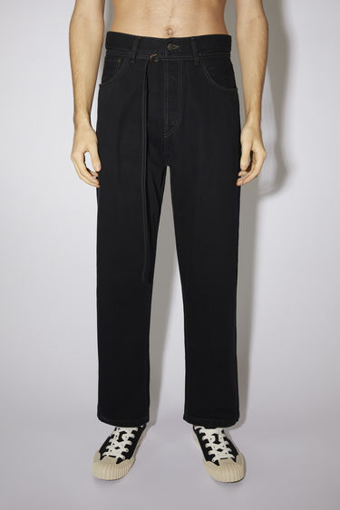 Acne Studios 1991 Toj Blk Dye jeans are crafted from rigid denim with wide, straight legs that's been lightly stonewashed. They can be worn on the natural waistline or pulled to a high rise with a matching belt.  The female model is wearing two sizes larger than her actual size to achieve a looser fit.