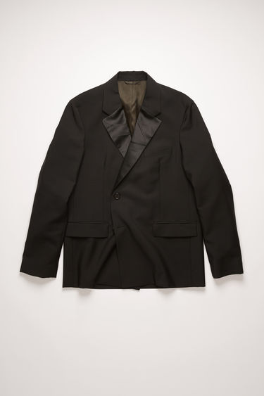 Acne Studios black suit jacket is made from midweight wool and mohair-blend to a double-breasted silhouette and is fully lined in satin. It's defined with crinkled satin lapels and padded shoulders and wrapped over the front with concealed buttons.