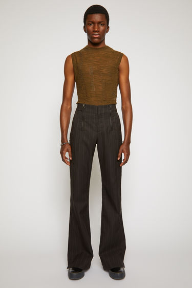 Acne Studios cacao brown pinstriped trousers are cut in a flared-leg shape with a mid-rise waistband, and features double metal zip closures and patch pockets.