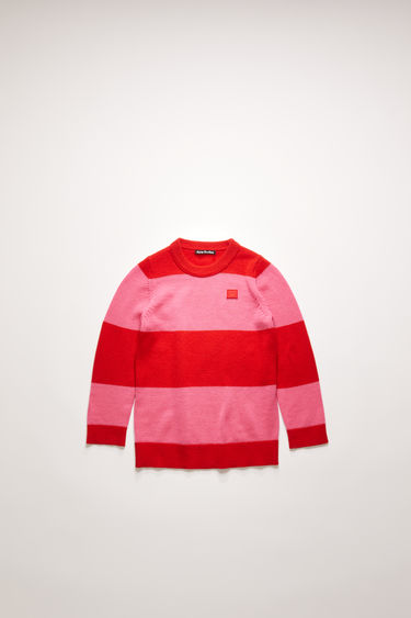 Acne Studios red/bubblegum pink block-stripe sweater is knitted from soft wool with a ribbed crew neck and accented with a tonal face-embroidered patch.
