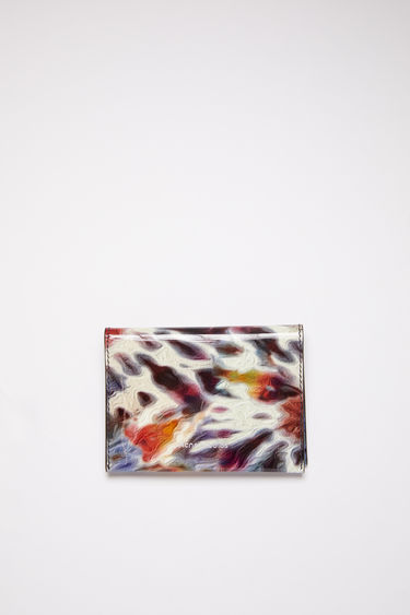 Acne Studios multicolor bifold card holder is made of tie-dye printed calf leather with four card slots and a gold stamped logo on the front.