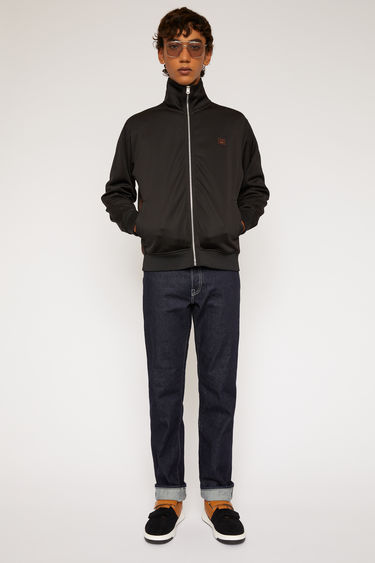 Acne Studios black tracksuit jacket is made from technical jersey and features contrasting ribbed panels along the side seams.
