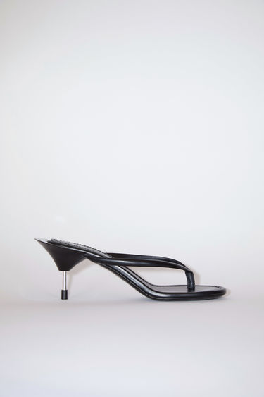 Acne Studios black sandals are made of calf leather, featuring a metal heel.
