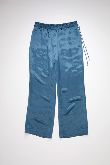 Acne Studios dusty blue casual satin trousers have a drawstring elastic waistband and relaxed fit.