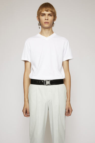 Acne Studios optic white t-shirt is crafted to a slim fit from soft cotton jersey and shaped with a V-neckline and short sleeves.