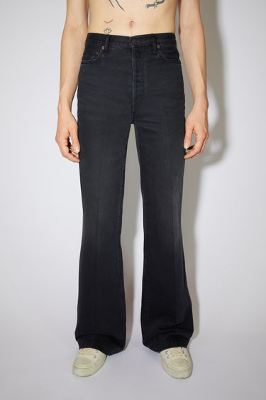 Acne Studios washed out black jeans are made from rigid denim with a mid rise and a bootcut leg.