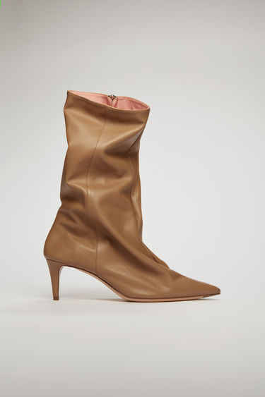 Acne Studios camel brown leather boots are crafted to a pointed toe set on a kitten heel and accented with a two-way metal zip.