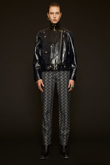 Acne Studios ink blue leather jacket is crafted to a classic biker silhouette and coated for a high-gloss finish. It features traditional peak lapels, a broad-belted waist and a D-shaped front pocket.