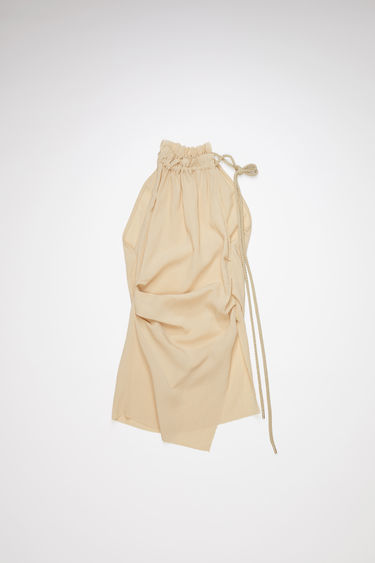 Acne Studios ecru beige crinkled crepe shirt is made of a viscose/silk blend with an asymmetric drawstring neck.