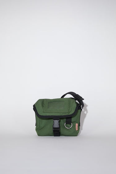 Acne Studios dark green durable small messenger bag has an adjustable hard plastic buckle closure and Acne Studios logo tab.