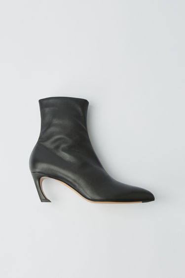 Acne Studios black ankle boots crafted from soft lamb leather with pointed toe and paired with a curved midi-heel.