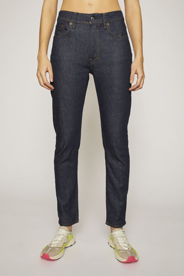 Acne Studios Blå Konst Melk Indigo jeans are cut to sit high on the waist and shaped to a slim, tapered silhouette.