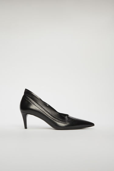 Acne Studios black pumps are crafted from grain leather to a pointed toe with unfinished edges, then set on a stiletto heel.