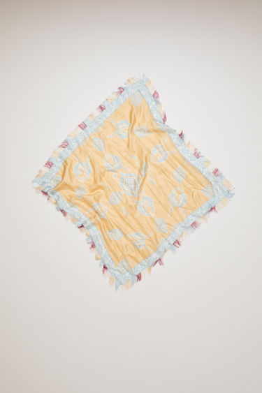 Acne Studios beige scarf is crafted to a square shape from a lightweight silk and then printed with Swedish folklore floral pattern along the borders.
