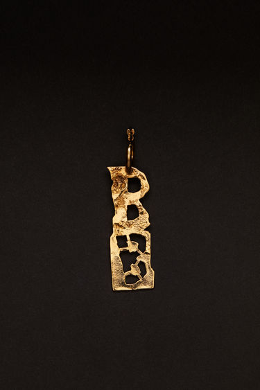 Acne Studios gold earring is crafted with a hammered pendant and features a stencil of the letter 'B', then secured via a hinge fastening.