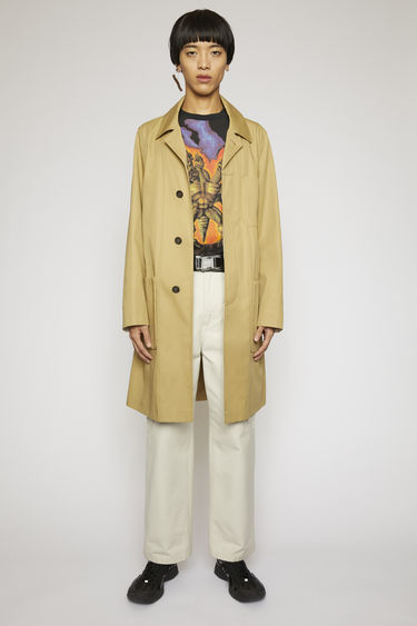 Acne Studios mushroom beige trench coat is crafted from technical twill with a subtle satin finish and has a concealed button placket, patch pockets and an unlined interior.