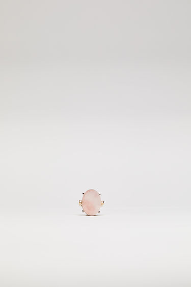 Acne Studios pink ring is crafted from gold-tone brass to a slim band and embellished with an oval-shaped faceted stone.