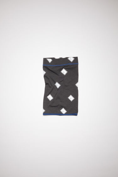 Acne Studios black neck gaiter has an all over reflective face logo design and contrasting stitching and binding.