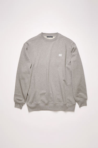 Acne Studios light grey melange oversized sweatshirt is made of organic cotton with a face logo patch and ribbed details.