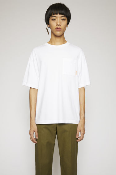 Acne Studios optic white t-shirt is cut to a boxy silhouette from soft cotton jersey and completed with a ribbed collar and a chest patch pocket.