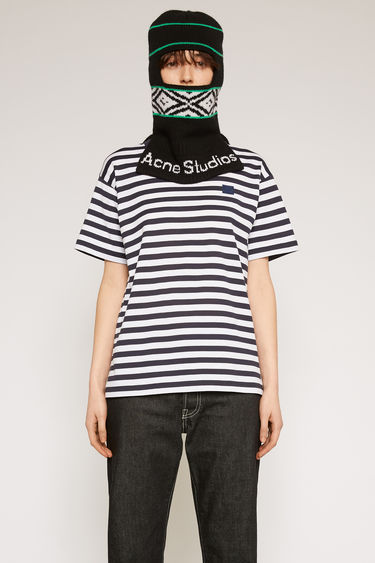 Acne Studios navy blue t-shirt is cut from lightweight cotton jersey that's patterned with breton stripes and features a tonal face-embroidered patch on the chest.