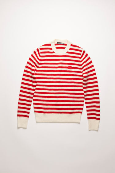 Acne Studios red/white stripe sweater is knitted in a fine gauge from soft wool yarns and accented with a tonal face-embroidered patch on the chest.