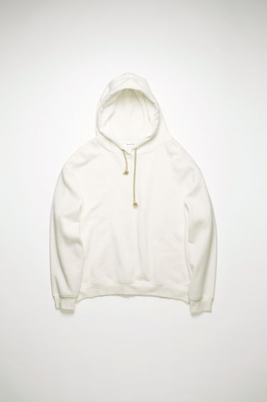 Acne Studios optic white hooded sweatshirt is cut to an oversized fit from brushed cotton jersey and neatly finished with ribbed cuffs and hem.