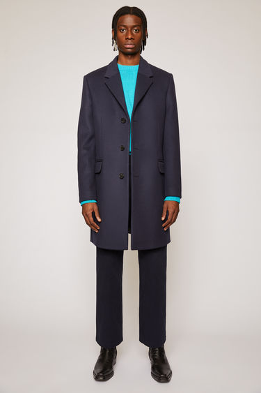 Acne Studios dark navy classic fit coat with notch lapel, three button closure and flap pockets.