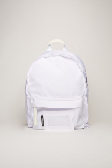 Acne Studios white backpack is crafted to a structured silhouette with a front zip pocket and features an adjustable crossbody strap, woven zip pullers and a transparent card pocket.